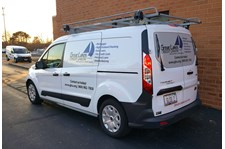Cut vinyl and window perf on van for Great Lakes Credit Union.  Bannockburn, IL
